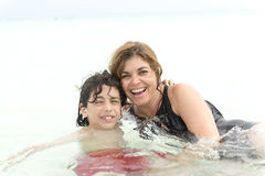 Hispanic mother and son enjoying tropical beach Stock Images