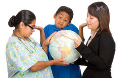 Hispanic Nurse, Teacher, and Boy Pointing to world Royalty Free Stock Photography