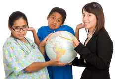 Hispanic Nurse, Teacher, and Boy Pointing to world Stock Image
