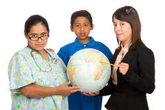 Hispanic Nurse, Teacher, and Boy Pointing to world Stock Photos