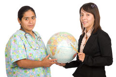 Hispanic Nurse and teacher holding the world Royalty Free Stock Photo