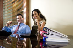 Hispanic office worker working with male colleague Stock Image