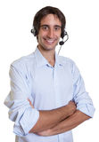 Hispanic operator with headset and crossed arms Stock Images