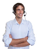 Hispanic operator with headset at work Royalty Free Stock Photos