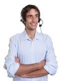 Hispanic operator with headset at work Royalty Free Stock Photos