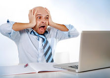Hispanic overworked frustrated businessman on tie screaming in stress at computer laptop Stock Photos