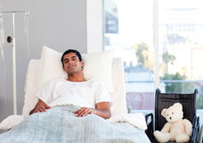 Hispanic patient resting in bed Stock Photo