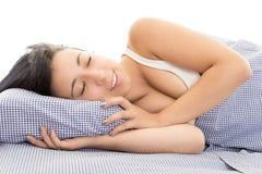 Hispanic peaceful beautiful woman sleeping in bed Stock Photos