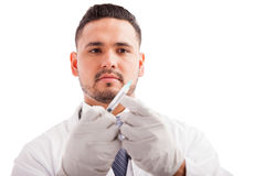 Hispanic pediatrician preparing a vaccine Royalty Free Stock Photography