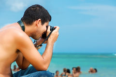Free Hispanic Photographer At The Beach Royalty Free Stock Images - 25851169