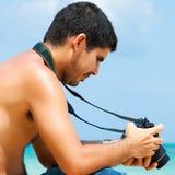 Hispanic photographer at the beach Stock Photo