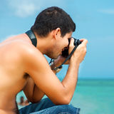 Hispanic photographer at the beach Stock Photos