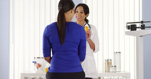 Hispanic physician talking to patient about new prescription royalty free stock photos