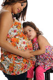 Hispanic Pregnant Mother with daughter Stock Photo