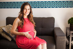 Hispanic pregnant woman at home Royalty Free Stock Photos