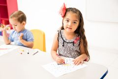 Hispanic preschool student coloring royalty free stock image