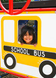 Hispanic Preschooler on playground bus Royalty Free Stock Images