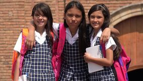 Hispanic Pretty Students Wearing School Uniforms. Group of young hispanic female children Stock Image