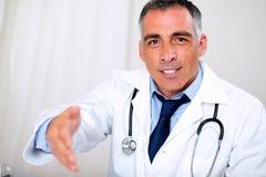 Hispanic professional doctor greeting Stock Photography