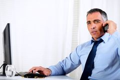 Hispanic professional man conversing on mobile Stock Photos