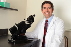 Hispanic Researcher Using Microscope Royalty Free Stock Photography