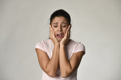 Hispanic sad woman serious and concerned crying desperate overacting on feeling depressed. Young beautiful hispanic sad woman serious and concerned crying Royalty Free Stock Photos
