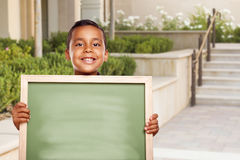 Hispanic School Boy Holds Blank Chalk Board on School Campus Stock Image