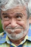 Bearded Old Male Under Stress. A hispanic senior adult male Royalty Free Stock Photo