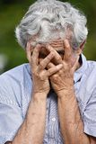 Hopeless Senior Person. A hispanic senior adult male Royalty Free Stock Images