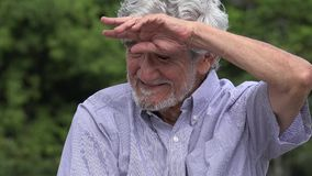 Irritated Senior Elderly Hispanic Man. A hispanic senior adult male stock video footage