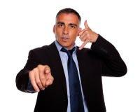 Hispanic senior broker pointing stock images