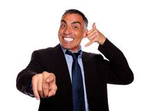 Hispanic senior businessman pointing Stock Images