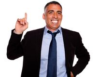 Hispanic senior businessman pointing up Royalty Free Stock Photos