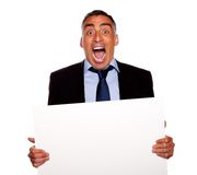 Hispanic senior businessman screaming Stock Photo