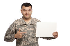 Soldier pointing to a blank sign Royalty Free Stock Photography