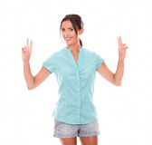 Hispanic in shorts making victory sign Royalty Free Stock Photography