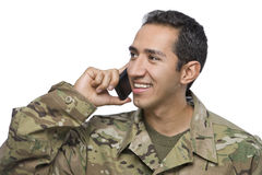 Hispanic Soldier Uses a Cellphone Royalty Free Stock Photography