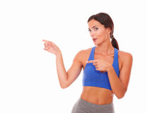 Hispanic sporty lady pointing to her right Royalty Free Stock Photography