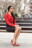 Hispanic stewardess in urban background Royalty Free Stock Photos