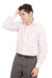 Hispanic stressed businessman in suit Stock Photo