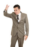Hispanic stressed businessman in suit Royalty Free Stock Images