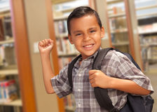 Hispanic Student Boy with Backpack in the Library Royalty Free Stock Photos