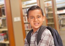 Free Hispanic Student Boy With Backpack In The Library Royalty Free Stock Photos - 75775738