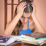 Hispanic student  exhausted after studying too much Stock Images