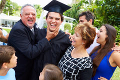 Hispanic Student And Family Celebrating Graduation. Happy Hispanic Student And Extended Family Celebrating Graduation stock photo