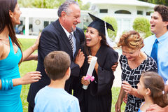 Hispanic Student And Family Celebrating Graduation. Outdoors Smiling At Each Other stock photos