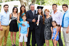Hispanic Student And Family Celebrating Graduation. Outdoors Smiling To Camera royalty free stock image