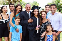 Hispanic Student And Family Celebrating Graduation. Smiling At Camera stock photography