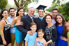 Hispanic Student And Family Celebrating Graduation. Smiling At Camera royalty free stock images