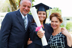 Hispanic Student And Parents Celebrate Graduation. Looking At Camera Smiling stock photography